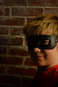 Middle School child in Superhero mask