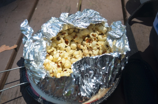Jiffy pop on the campfire. Rebelling against the instructions tastes delicious.